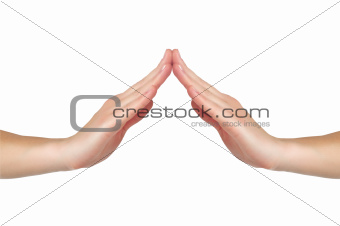 female hands touch each other in form of a house or a roof isola