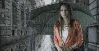 beautiful woman with umbrella under the rain