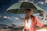 girl with umbrella, on sunset and under summer rain