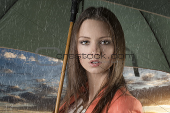close up beautiful woman with umbrella under rain