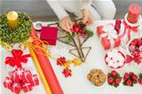 Closeup on table where woman making Christmas decorations. Upper view