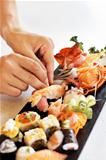 Chef hands preparing fresh sea food platter
