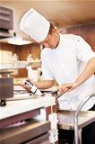 Young chef working in kitchen
