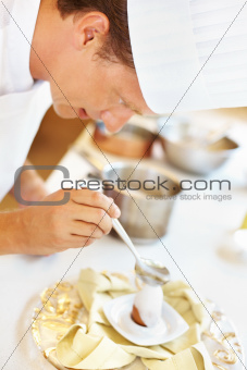 Chef in the kitchen preparing an egg