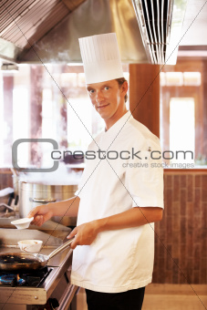 Smart young chef in restaurant kitchen