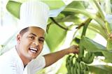 Portrait of happy chef near banana tree