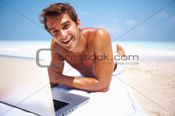 Happy man using laptop