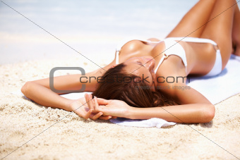 Sexy woman lying on beach