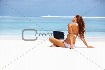 Woman connected at beach