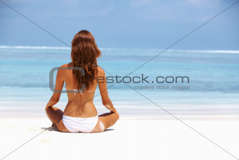 Woman in meditation at beach