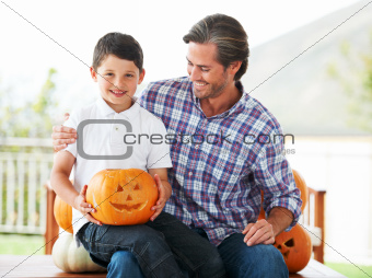 Carving pumpkins with dad