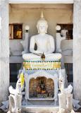 Shrine with white stone Buddha