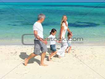 Happy family on summer beach vacation