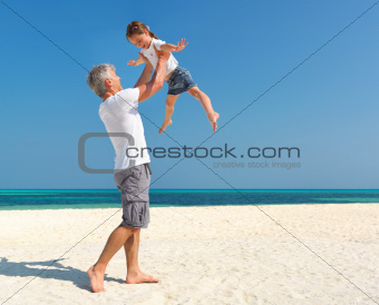 Father and daughter enjoying beach vacation