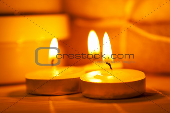Miniature candles on a bamboo mat