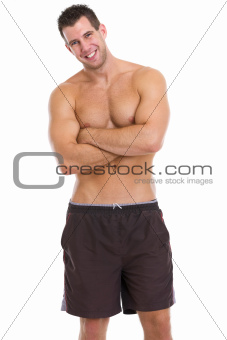 Portrait of healthy muscular guy in shorts