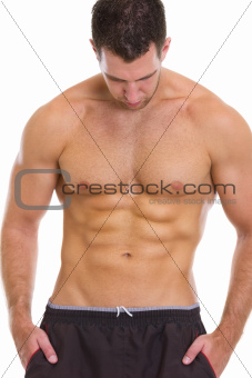 Muscular guy showing abdominal muscles