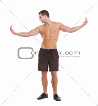 Healthy man showing muscular body