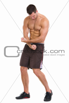 Fitness man showing muscular body