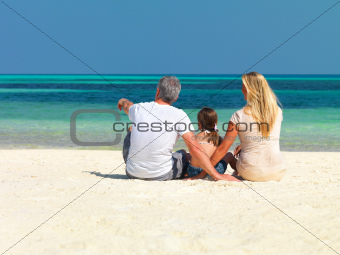 Family on vacation relaxing at the beach