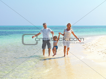 Happy vacations - Family playing at the beach