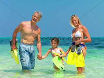 Happy family in the sea with snorkeling gear