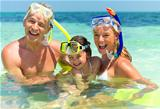 Happy family with snorkels having fun