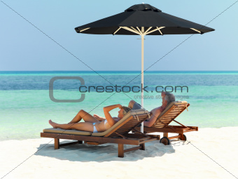 Couple relaxing on beach under umbrella