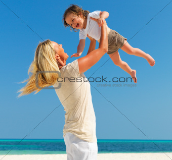 Mother and daughter playing together on a beach
