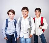 Three happy schoolboys