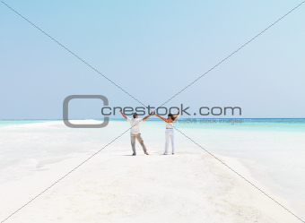 Couple on the beach enjoying the weather