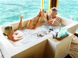 Happy mature couple taking bath together in a bath tub