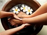 Woman getting relaxing pedicure at spa