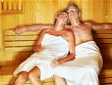 Mature couple enjoying a hot sauna