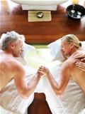 Mature couple enjoying a back massage at spa