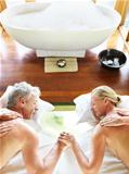 Relaxed mature couple in spa treatment