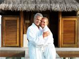 Romantic mature couple together in bathrobe