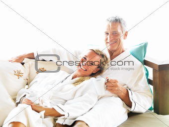 Portrait of mature couple lying on bed