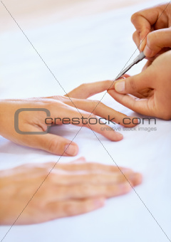 Beautician working on hands