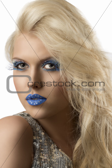 blonde girl with euro flag make-up, she looks in to the lens