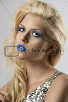 blonde girl with euro flag make-up, she is turned of three quart