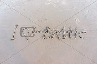 I love Baltic. Inscription on white sand of Baltic beach.