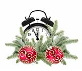 Green Christmas tree, decorative red balls and alarm clock isola