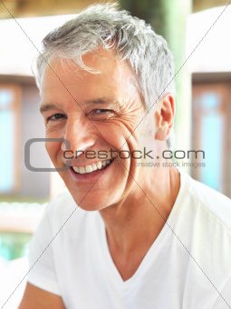 Closeup of confident mature man smiling
