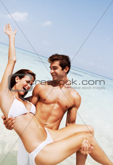 Romantic young couple having fun on the beach