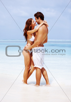 Happy couple at the beach in a romantic mood