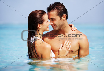 Portrait of a romantic young couple in the sea