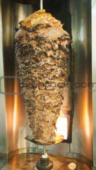 Large beef kebab on a spit roast