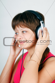teenage girl listening to music on headphones