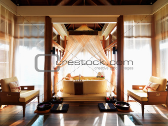Woman lying in bathtub at resort